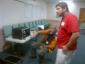 Chris Nienow of Wilmington, NC (right) and Kerry Karusse (Emergency Communication Coordinator with ARES) worked to set up satelitte communications in Elizabeth City, NC during Superstorm Sandy.