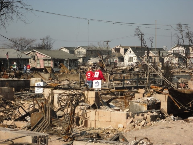 A Red Cross worker from Wilmington, NC helps out in Breezy Point NY after Superstorm Sandy