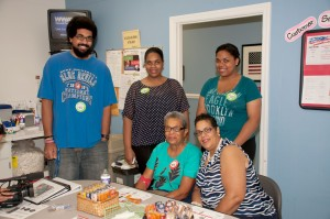 Carole Bryant (center) at Wilmington Blood Center with family. From left to right grandkids Tauriq Watson, Faaria Watson, Azziza Watson and daughter Leslie Watson - Photo Credit Bill Ritenour