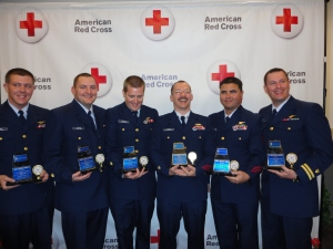 Members of the Coast Guard in Elizabeth City, NC receive awards from the Red Cross for the HMS Bounty Rescue during Superstorm Sandy.