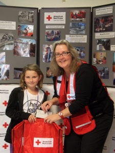 Eight year old Rileigh Pedersen of Wilmington, NC sold cookies in her neighborhood to help victims of Superstorm Sandy and brought in a $208 check to the local Red Cross.