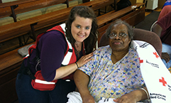 Disaster volunteer Amy Parsons assisting residents at a shelter in Kinston NC after an apartment fire displaced 150 people from their homes in June 2013.