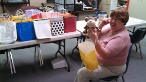 Greater Albemarle Area Chapter CEO, Carolyn Self, recives the delivery of Happy Sacks for kids during disasters.