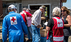 The Harris Family receives supplies and support from Red Cross volunteers.