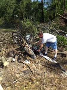 Duncan Blevins, a Beaufort County resident, tries to untangle his son's bicycles melded together by a massive tornado last week.
