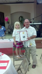 Future Red Cross volunteer Gloria Hite receives her award from Board Chairman Mike Ciccarelli