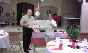 Sheriff Ed Brown accepts the volunteer in kind check from board chair Mike Ciccarelli