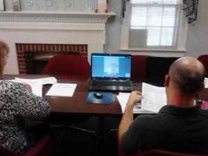 Two prospective volunteers having a Skype Volunteer Orientation with Program Specialist, Shannon Kelly-Miller.