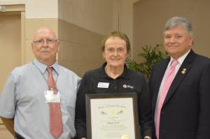 Margaret Idol, Order of the Long Leaf Pine Award recipient, Edward Buck, volunteer and State Rep. Philip Shepard.