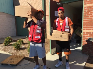 adrian-guerrero-l-and-son-isaiah-carry-boxes-of-in-kind-items-from-the-westover-shelter-in-fayetteville