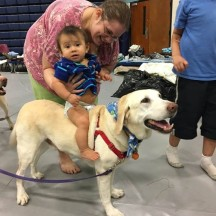 """Barbara Penny and her two sons (pictured is her youngest, Taelyn, who is just nine months old) have also been staying at the shelter since the hurricane hit. When they were told to evacuate their house Barbara says, """"the only thing that mattered to me was to get my kids out and make sure I had everything they needed. My babies mean everything to me."""""""