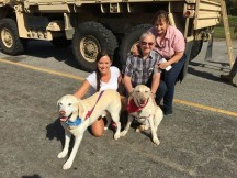 Nathaniel and Cooper, with their mom and grandparents outside the shelter, getting ready for the journey back home.